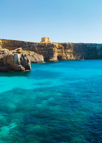 Comino island. Tower, Cliffs and blue lagoon. Malta country
